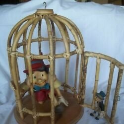 Walt Disney Pinocchio And Jiminy Cricket Statues In Wooden Cage