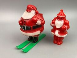 2 Vintage Hard Plastic Rosbro Candy Container Santa Claus Ornament And Skis