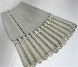 Set Of 12 English Sterling Silver Shell Pattern Knives. 9.75