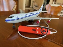 Joustra Toys - Remote Control Battery Operated Air France 747 Tin Toy Airplane