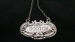 An American Stamped Sterling Silver Scotch Decanter Label