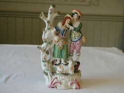 Staffordshire Figurine Of Couple Standing By A Tree With A Lamb At Their Feet
