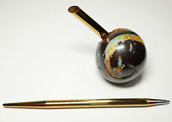 53399.0 Polished Boulder Opal Ball With Gold Colour Pen Holder And Ball Point Pen