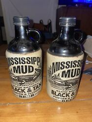 Two 1998 Mississippi Mud Black And Tan Beer Bottle Jugs Twist Top Cap Empty 1 Pint