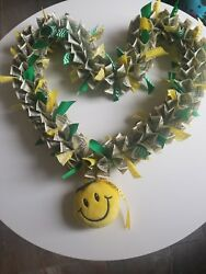 Money lei with ribbon and stuffed emoji for graduation $90.00