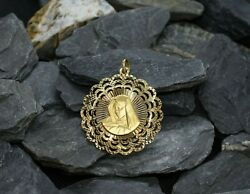 Large 14ky Gold Diamond Cut Double Sided Disc Pendant Featuring Jesus And Mary