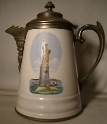 Graniteware Pewter Trimmed Coffee Pot With Statue Of Liberty