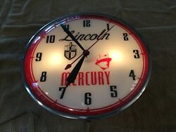 1950's Lincoln-mercury Dealer Pam Clock. Lights Up And Runs. Keeps Good Time