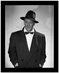 John Wayne in a bowtie coat and hat High Quality Photo