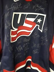 2002 Olympic Mens Usa Hockey Jersey Signed By 23 Players And A Total Of 26 Sigs.