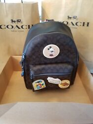 COACH DISNEY X BACKPACK WITH MINNIE MOUSE PATCHES