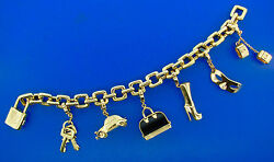 HEAVY AND CHIC Louis Vuitton 18k Yellow and Onyx Gold Link Charm Bracelet