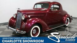 1937 Packard Business Coupe Restomod classic vintage chrome Edelbrock white wall tan burgundy restored upgraded front