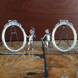 Matched Pair Of Antique Solid Silver Oval Easel Frames With Cherubs