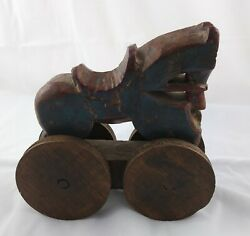 Antique 18th Century Folk Art Red And Blue Carved Wood Horse On Wheels Pull Toy