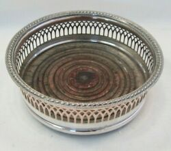 A Vintage Silver Plated Wine Bottle Coaster