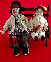 Two 1980s Collectible Porcelain Large And Colorful Musical Dolls
