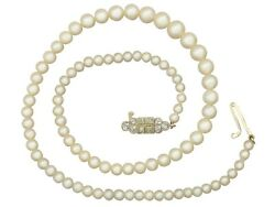Single Strand Pearl Necklace With 0.56 Ct Diamond And 15 Ct Yellow Gold Clasp