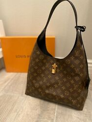Louis Vuitton Monogram Canvas and Black Leather Flower Hobo Bag $1800.00
