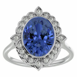 14k Gold 1.5 Carat Oval Shape Tanzanite And Halo Diamond Ring In 3 Gold Colors