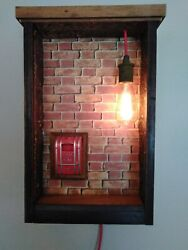 Light With Vintage Fire Alarm, Old Metal Ceiling Tiles And Old Scrap Wood