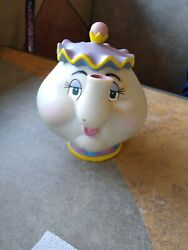 Early 1990's Mrs. Potts Bank And Chip Cup Plastic Figurines. Sold As A Set.