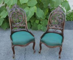 Pair Of 19th Century Belter Style Carved Walnut Chairs With Green Upholstery