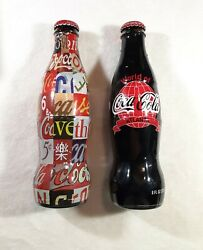 2 2006 World Of Coca Cola Wrapped Bottles - Vintage Signs And Las Vegas