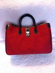 Dooney and Bourke red cloth satchel with dark brown trim excellent preowned $100.00