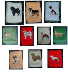 personalised flannels face cloths with dogs and names embroidered on.