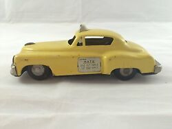 Vintage Japan Tin Friction Yellow Taxi Cab Toy