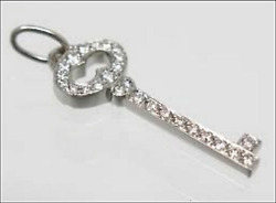 And Co Platinum Diamond Encrusted Oval Key Pendant Suede Box