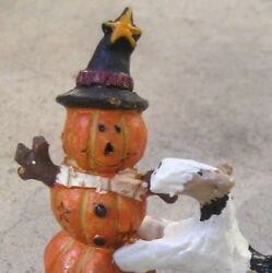 Wire Fox Terrier greeting a STACKED PUMPKIN SCARECROW!