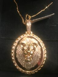 14 Kt Gold And Diamond Lion Head Pandant And Chain.