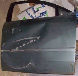 Sperm Whale Like Impression In/on Door Of 2006 Mercury Montego Signed If Asked