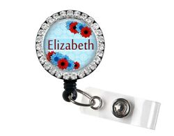 Personalized Bling Badge Reel With Red And Blue Flowers On Blue Background 3b