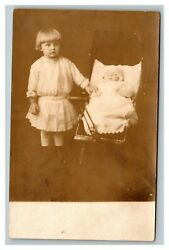 Vintage Early 1900and039s Rppc Child And Baby In Stroller Studio Portrait Unposted