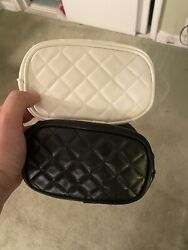 Cosmetic cases. Two 2. Black amp; White. No Tags But In Plastic Cover $11.10