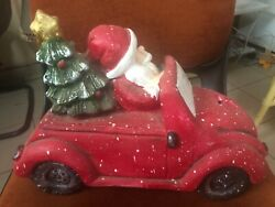 Santa Claus Driving Red Vintage Beetle With A Christmas Tree Table Top Decoratio