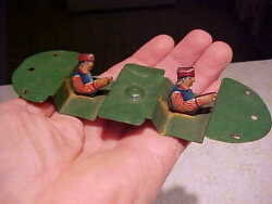 old tin toy piece for a lindstrom windup