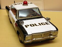 nissan police stick shift tin toy car