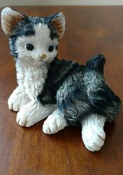 Long haired laying down striped black and white cat Kitten resin figurine