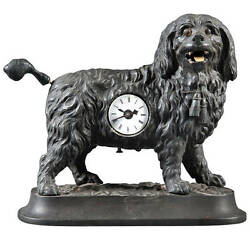 A Very Fine 19th Century German Cast Iron Clock with Moving Tongue