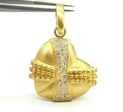 VINTAGE 18K YELLOW GOLD DOME HEART PENDANT WITH ROUND CUT DIAMONDS.