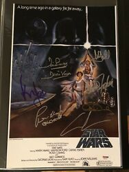 CARRIE FISHER HARRISON FORD SIGNED STAR WARS A NEW HOPE PHOTO 12X18 AUTOGRAPH