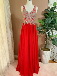 Elegant red evening gown with rhinestone and sequin top $85.00