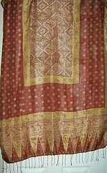 Scarfhijab rust and gold colors with floral designs  76 X 36 inches $9.99