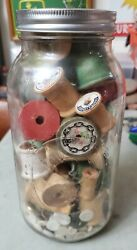 Vintage Mixed Colored Wooden Sewing Thread Spools And Buttons In A Large Ball Jar