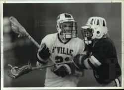 1992 Press Photo W Genessee High Lacrosse Player Checks Band039ville High Player