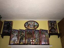 A Complete Set Of Wizard Of Oz Pink And Silver Label Barbie Dolls And More